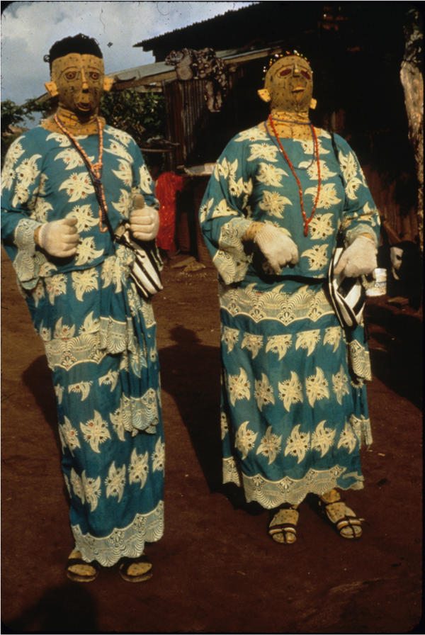 A pair of masqueraders honors the spirits of departed twins, 1986.