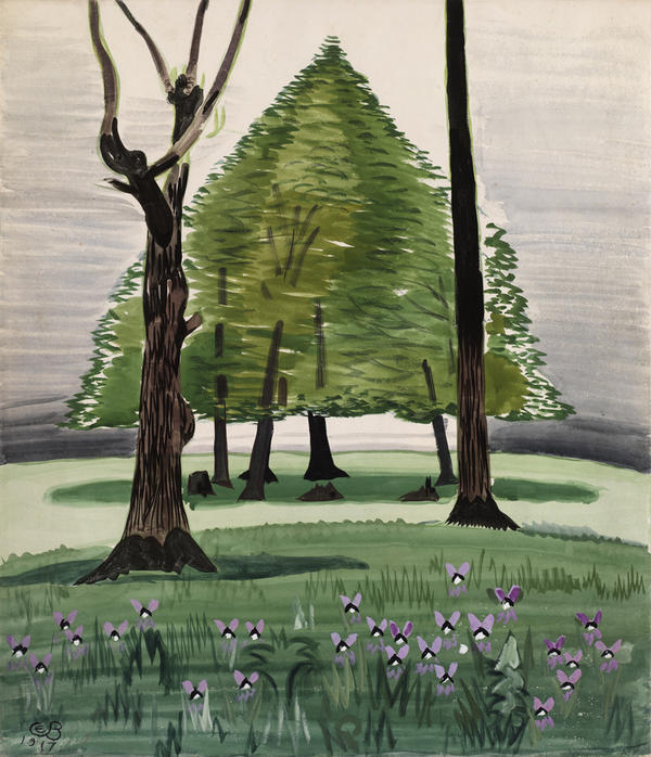 Violets in green foreground, two bare tree trunks in middle distance, trees with foliage on lighter green ground, background and sky, lavender.